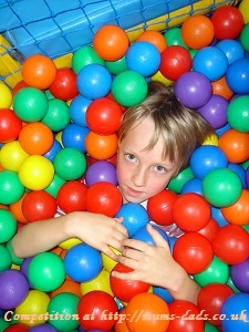 Boy playing with bright and colourfuul balls