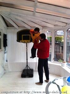 Boy and Dad plaing bascketball
