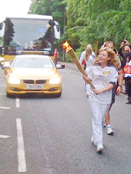Former Withington Girsl's School Pupil Sasha Carter Carried the Olympic flame along Chorley New Road in Bolton