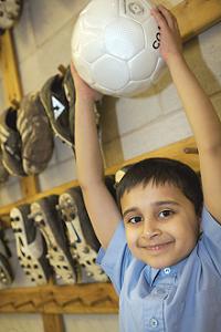 boy with football ball