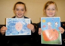 Alexandria McLelland and Liberty MacLeod with their winning paintings for Junior Painter of the Year competition