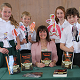 Mrs Kate Sargent and CHS students Anna Cusworth, Oliver Brown, Isabelle Ashworth and Thomas Scott, with props which illustrate the costumes worn at the time the book was set.