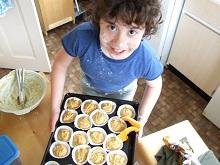 Kids will love to help making pumpkin muffins for Halloween