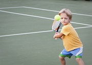Playing Tennis at Tennis Tykes Summer Holiday Camp