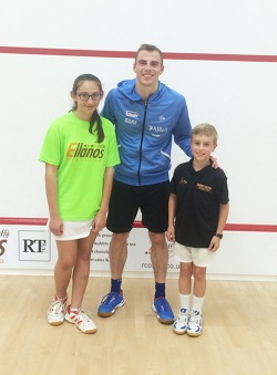 Myles Maguire with Nick Matthew after squash exhibition match