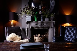 Dark interior paint colours give the room wormer and welcoming feeling