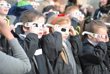 Junior children at Stockport Grammar School are watching solar eclipse.