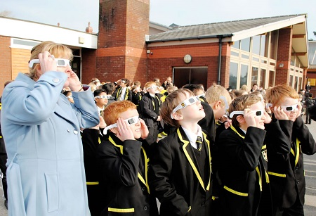 All the children at SGS are watching solar eclipse together.