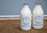 Bottles of Creamline Dairies Milk