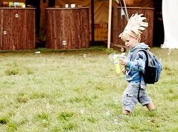Child running and making bubbles | Run Wild, Child event, Manchester
