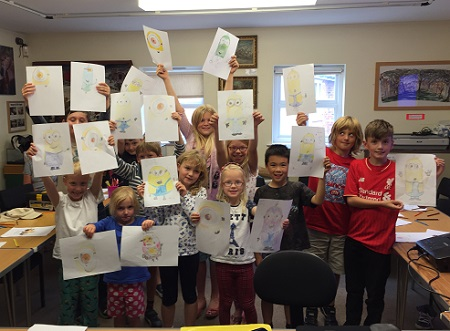 Kids show their work at the Cartoon Academy workshop