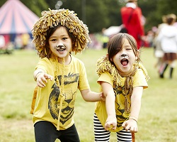 Kids dressed up in lion costumes for Tribal Tournament at last year festival