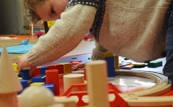 playing with wooden toys at Mini Sparks