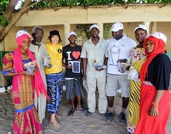 Community leaders in Illiassa accept solar lamps donated by the Withington Gambia group to help local people.