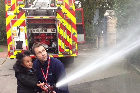 Firefighter and AESG pupil