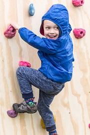 Child enjoys climbing wall at the Geronimo Festival