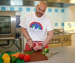 Simon Rimmer demonstrates his culinary skills in the new kitchen at Francis House.