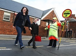 A family crossing street safely | Walk to School Week, Manchester