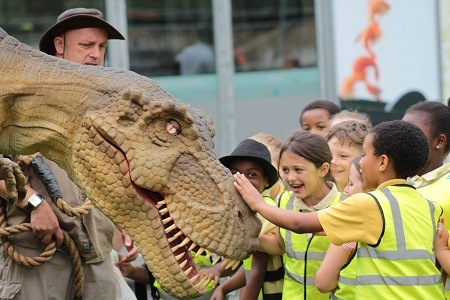 Year 3 pupils from Lark Hill Community Primary School, Salford, enjoy meeting the T-Rex