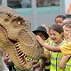 School children and a dinosaur | Jurassic Kingdom