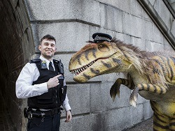 dinosaur and a policeman