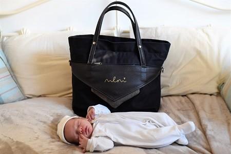 Sleeping baby and maternity bag
