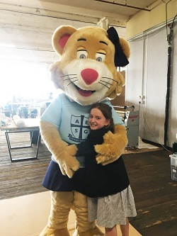 Liberty the Lioness, new AESG junior mascot with one of the pupils