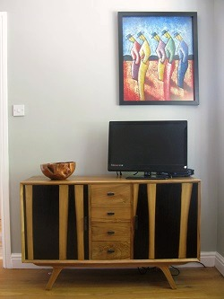 Wood, dark purple and grey living room, opposite side | Decorative ideas from Nest Interior Design
