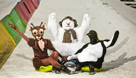 Snowman, reindeer and penguin from The Snowman show on the slope of Chill Factore