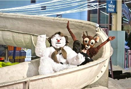 Snowman, reindeer and penguin from The Snowman show on the Luge Slip 'n' Slide at Chill Factore