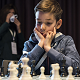 Ethan Gardiner thinking in the game against Vishy Anand